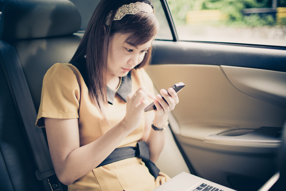 Checking phone in car